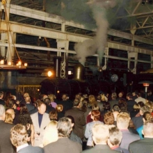 The steam engine comes hissing and puffing into the crowd